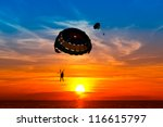 Silhouette Of A Para Sailor At...
