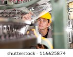 textile factory quality controller checking yarn - stock photo