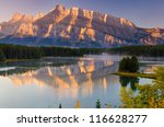 Cascade Mountain at first light reflecting upon Two Jack Lake