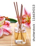 Fragrance sticks or Scent diffuser with lily flowers - stock photo