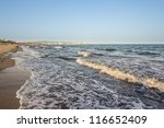Beautiful beach by the shores of the Mediterranean sea in Hammamet, Tunisia - stock photo
