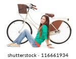 Woman with her bike - stock photo