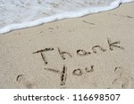 Concept or conceptual Thanksgiving day holiday text handwritten in sand on an exotic beach as metaphor to America,american,tradition,gratitude,message,celebration,greeting,traditional made in vacation - stock photo