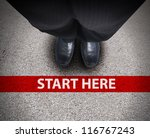 a business man is looking down... | Shutterstock . vector #116767243