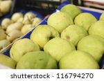 Appetizing quince in supermarket - stock photo