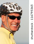 Closeup portrait of man wearing a helmet and shades - stock photo