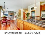 Wood luxury large kitchen with island, red and granite. - stock photo