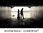 silhouette of a couple on...