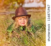 beautiful small girl on green... | Shutterstock . vector #116871967