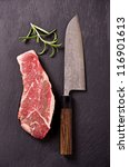 Small photo of beef steak with santoku knife