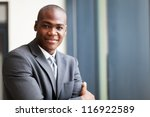 peaceful african american businessman in office - stock photo