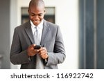 young african american businessman reading email on smart phone - stock photo