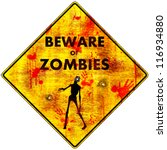 Beware of Zombies - Bloody: a bloody caution road sign with gunshot holes warning you to beware of zombies in the immediate area, pictured with a zombie reaching out. Isolated. - stock photo