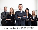 Group of business people with businessman leader on foreground - stock photo