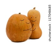 Two pumpkins in love on white background - stock photo