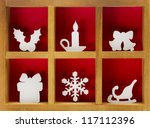 Christmas decoration hand cut and crafted from paper, wooden printer tray. - stock photo