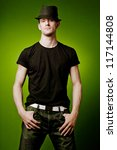 Young handsome tall man posing in black t-shirt. - stock photo