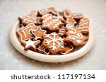 Plate of christmas cookies with festive decoration - stock photo