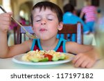 Cute little boy enjoying food - stock photo