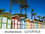 Row of summer beach cabins in panoramic design. - stock photo