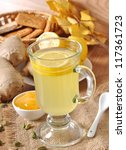 Healthy ginger tea with lemon and honey on the table - stock photo