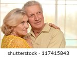 nice elderly couple posing in... | Shutterstock . vector #117415843