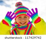 Winter fun, kid winter playing - lovely girl has a fun in snow - stock photo