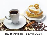 Cup of coffee, cake in the form of a swan and coffee beans - stock photo