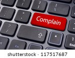 to illustrate poor customer service, with complain message on keyboard. - stock photo