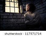 Woman prisoner in a straitjacket - stock photo