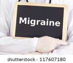 Doctor shows information on blackboard: migraine - stock photo