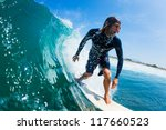 surfer riding large blue ocean... | Shutterstock . vector #117660523