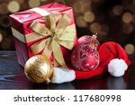 Christmas present with defocused glittering lights background - stock photo