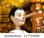 ROME - JULY 8: Tourists visit the studio of woodcarver named Geppetto on July 8 2011, Rome. The Adventures of Pinocchio, by Carlo Collodi, are one of the most famous children's novel in the world. - stock photo