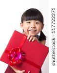Happy Asian child girl with red gift box for Christmas theme - stock photo