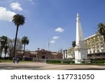 The Plaza de Mayo ((English: May Square) is the main square in Buenos Aires, Argentina. In the background, the Casa Rosada (Pink House). The pyramid of May can be seen in the right. - stock photo