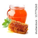Fresh honey with honeycombs and mint - stock photo