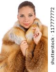 Young woman in luxury fur coat isolated on white background - stock photo