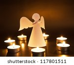 Christmas angel with candles over dark background. Artwork is created by myself. - stock photo