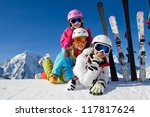 Skiing, winter, snow, sun and fun - skiers enjoying winter vacations - stock photo