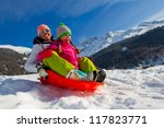 Sledding, winter fun, snow, family sledding at winter time - stock photo