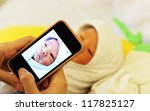mother use her mobile phone... | Shutterstock . vector #117825127
