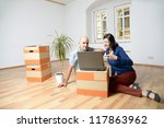 young couple moves the house - stock photo