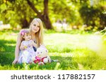 young mother with little... | Shutterstock . vector #117882157