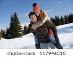 Young couple having fun on the snow - stock photo