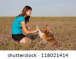 Pretty girl with her dog - stock photo