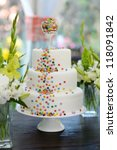 Delicious white wedding cake decorated colorful candies - stock photo