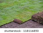 rolled sod for new lawn - stock photo