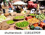 VARANASI - APRIL 23: Market vendors selling vegetables on a market on April 23, 2011 in Varanasi, India. India ranks second worldwide in farm output. Agriculture employs 52.1% of the total workforce - stock photo