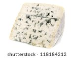Piece of blue cheese in front of white background - stock photo